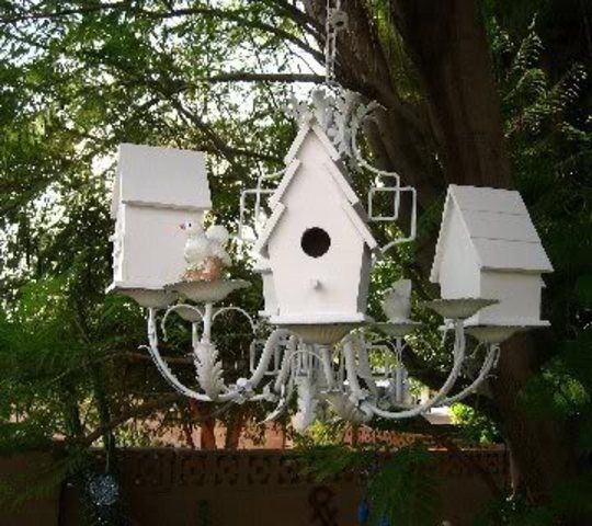 Repurpose old chandelier into a bird house complex. ** if you found one at a garage sale***