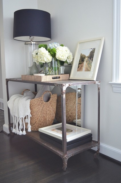 Nice neutral arrangement, lamp, basket, flowers, picture, throw