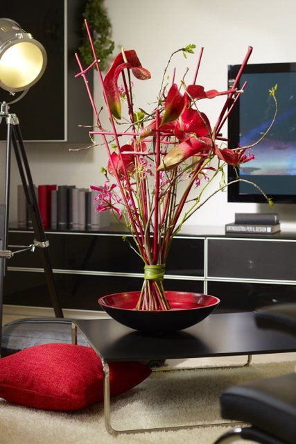Be different! Arrangement with big Anthuriums, Gloriosa. Modern and seasonal at the same time.