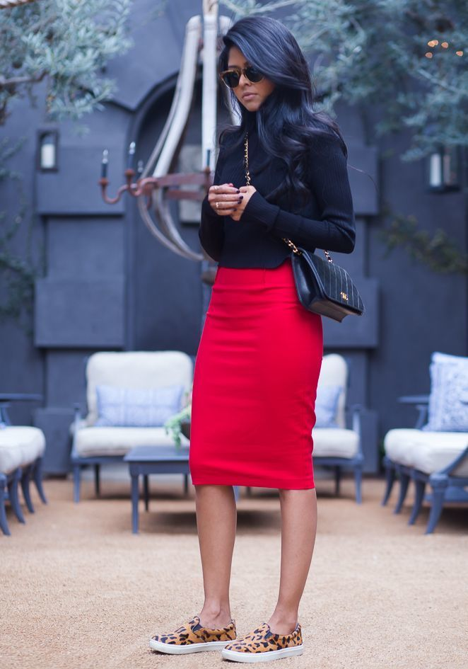 A black turtleneck and a red pencil skirt are a combination that every stylish girl should have in her wardrobe. Why not add camel leopard slip-on sneakers to the mix for a more relaxed feel?   Shop this look on Lookastic: https://lookastic.com/women/looks/turtleneck-pencil-skirt-slip-on-sneakers-crossbody-bag-sunglasses/13040   — Brown Leopard Sunglasses  — Black Turtleneck  — Black Quilted Leather Crossbody Bag  — Red Pencil Skirt  — Tan Leopard Slip-on Sneakers