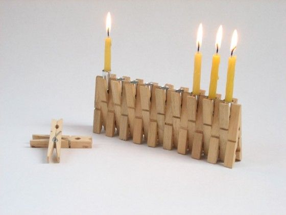 Gad has two versions of the menorah made from clothespins one with oil and one with candles.