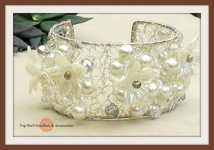 EDITOR'S CHOICE (01/03/2017) Pearl Flower crochet wire cuff bracelet by Top Shelf Jewellery & Accessories View details here: http://jewelers.community/creations/4125-pearl-flower-crochet-wire-cuff-bracelet