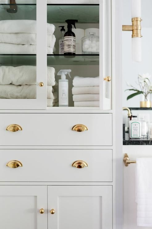 Glass Front Bathroom Linen Cabinet with Polished Brass Hardware