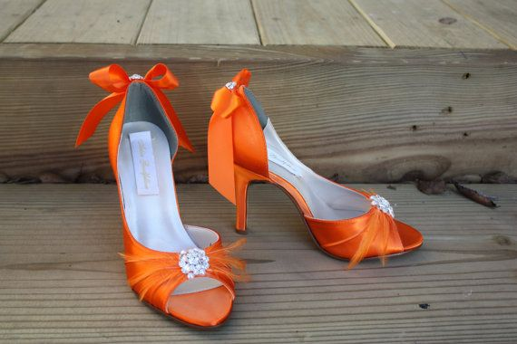 Adorable orange shoes with feathers Available on etsy.com