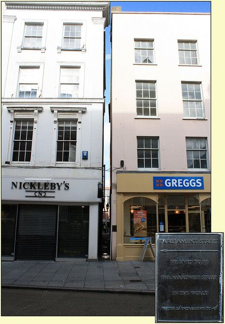 Parliament Street, Exeter, UK - As the plaque says, it could be the narrowest street in the World. 25 inches at its narrowest.