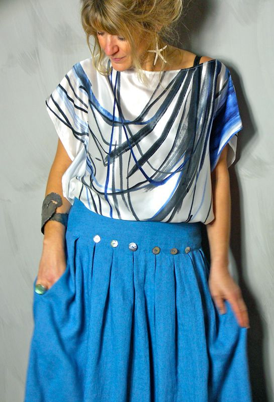 Silk T' Shirt Top £115, tucked into Button Skirt £235.