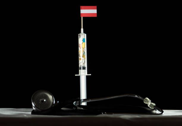 stethoscope and syringe filled with drugs injecting the austrian flag