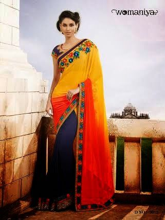 Beautifully designed Shaded Yellow Orange with Navy Blue Georgette saree with heavy embroidery work en-crafted all over. Comes along with Contrast matching Navy Blue Blouse.
