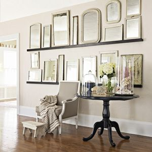 Make a gallery-esque wall of picture ledges using several short shelves to create one super-long one. #decorating