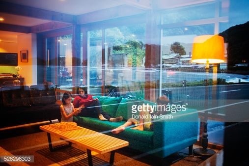 Mother and children relaxing together in modern living room
