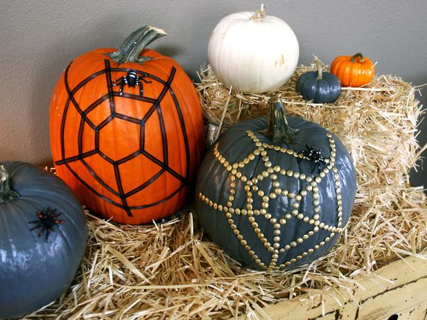 #Halloween decorating:  bling out pumpkins with upholstery trim.