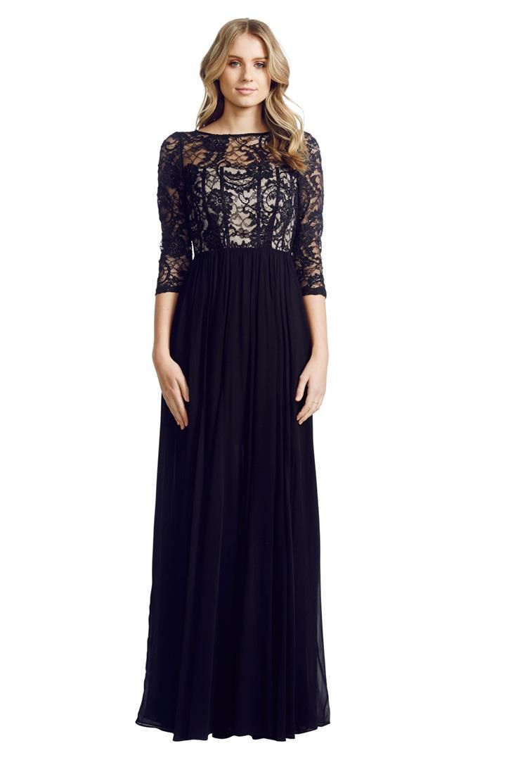 This stunning floor length gown by Alice + Olivia is the picture of understated elegance. The flowing layered skirt is beautifully offset by delicate beading and sequins on the bodice. Modest three quarter sleeves and a flattering round neckline are balanced by sheer lace at the décolletage and a satin-trimmed mesh back. Perfect for any black-tie event or ball! Flowing; layered silk skirt Sheer beaded top with ecru bodice Delicate satin-trimmed boning Three-quarter sleeves.