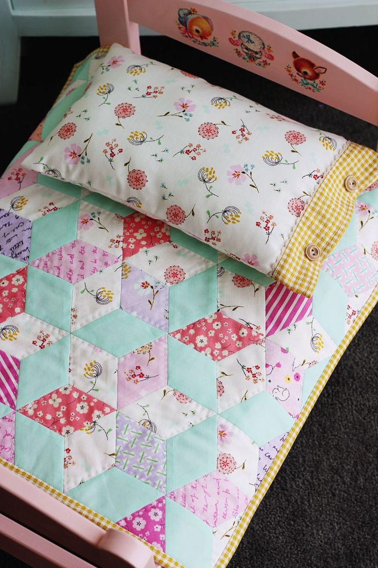 The sweetest doll bed...Plain IKEA doll bed, painted and added decals, then handmade diamond pattern quilt and matching pillowcase - PERFECTION!!!