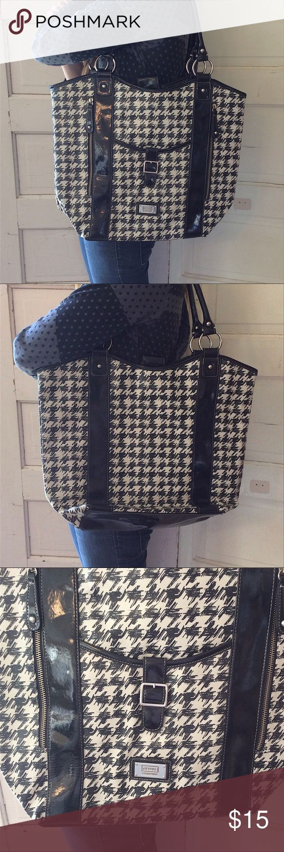 Oversized Black & Off-white Merona Tote Oversized Tote in great condition - no holes, rips or stains. Shiny black trim. Main compartment has a snap closure. Two outside zipper pockets on front. Snap pocket on front. Zippered pocket inside as well as two open pockets. Merona Bags Totes