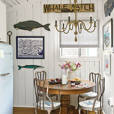Such a small corner, but filled with interest and still doesn't feel or look cluttered.  Notice the blue vintage refrigerator to add a simple touch of coastal.