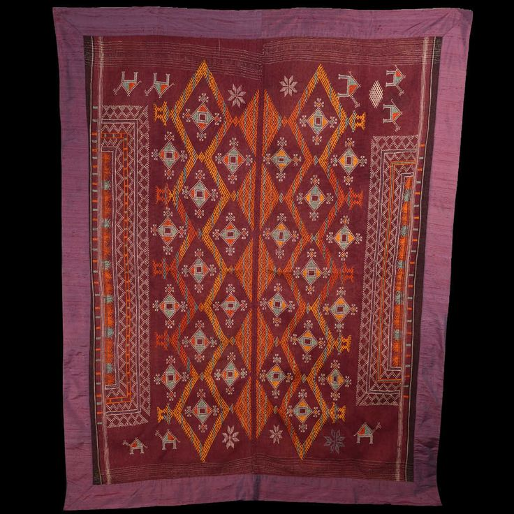 The odhani is a large rectangular cloth worn by Indian women also covering the head. This textile is an ancient bridal shawl, embroidered with cotton on wool, from the historical region of Shekhawati in Rajasthan. This odhani was sewn on a shantung fabric that enhances the colors and protects it. Size: 200 x 150 cm.
