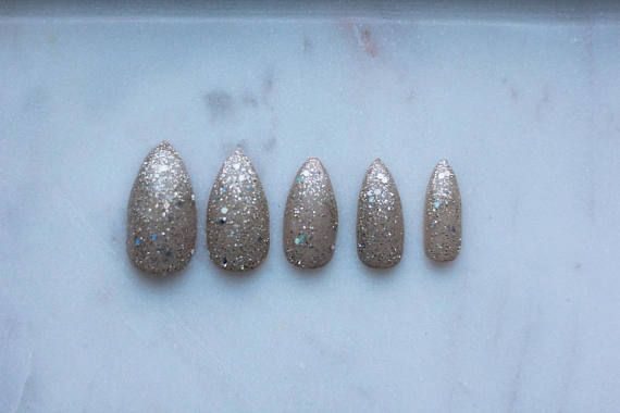 Twinkle in the Buff  This set is super pretty with a Nude / Buff Base with Mized Size Gold and Silver Glitter  This is a FULL SET 24 : Comes in various sizes and shapes  The sample picture is in a size  Medium Stiletto  $16.00 in a Gel / Shellac Finish All sets come with Nail Glue  #nails #nailart #beauty #nailgame #presson #pressonnails #glitter #glitternails #pressons