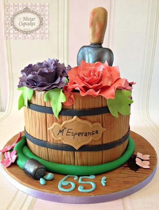 Flowerpot cake. The pot is a delicious chocolate cake. The potting soil is crushed oreo cookies. And the flowers are made with sugar as the garden shovel.