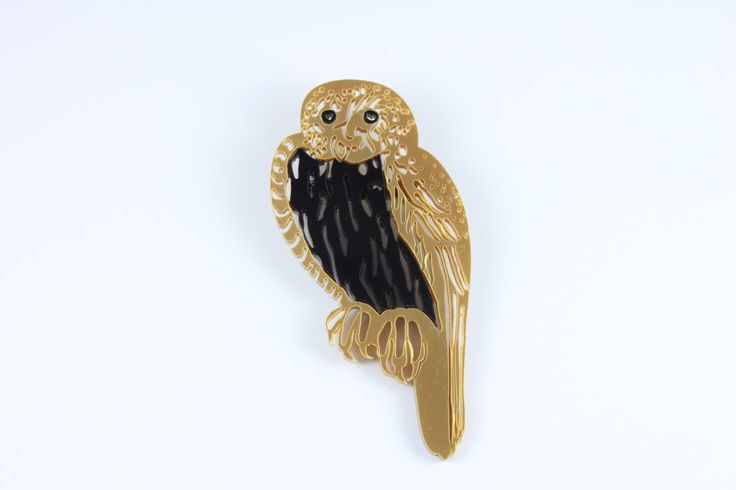Gold owl pin.