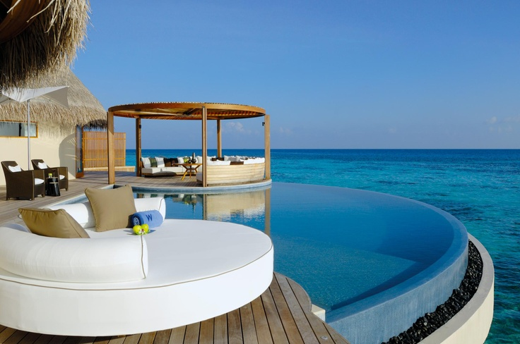 Okay, gorgeous, Maldives, right -    But what really gets me is the circular couch there.  Gotta be a way for me to work that in someday, because it's pure genius.