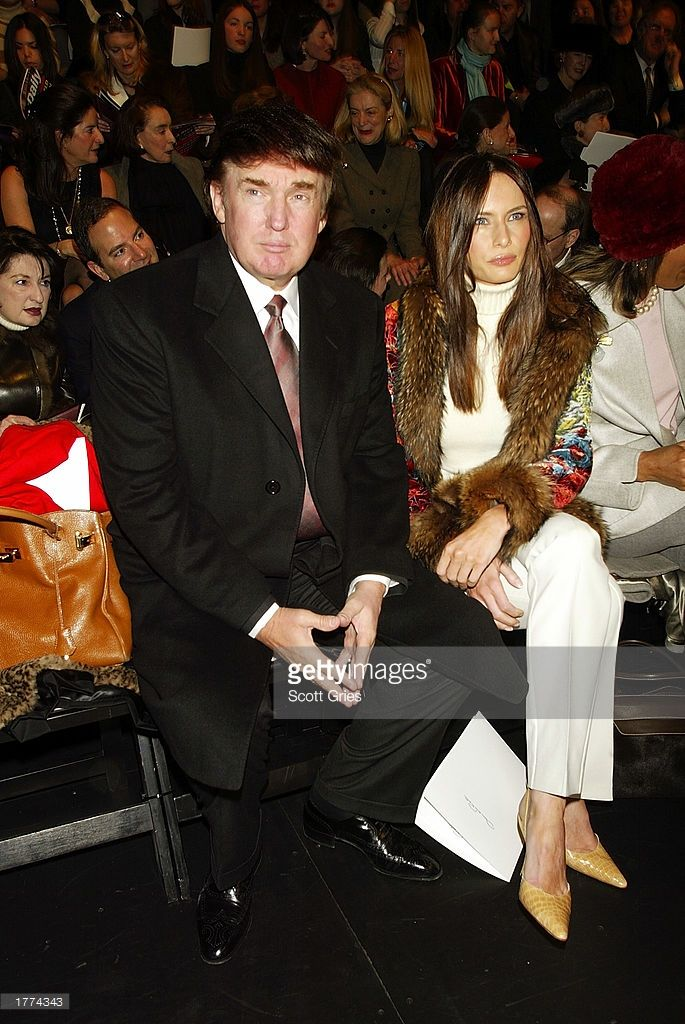Donald Trump with girlfriend/model Melania Knauss attend the Oscar De La Renta fashion show for the Fall/Winter 2003 Collection at The Pavillion in Bryant Park during the Mercedes-Benz Fashion Week February 10, 2003 in New York City.