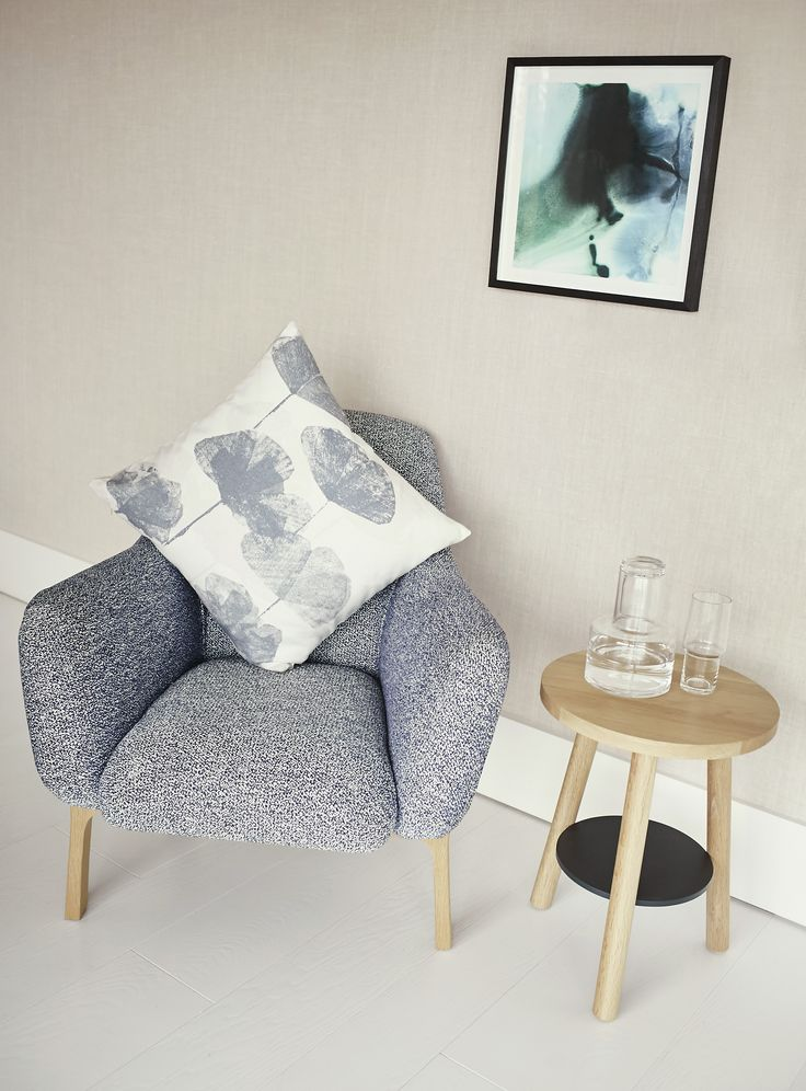 This stylish armchair features curved sweeping lines and a high degree of comfort complete with beautifully shaped solid oak legs. Pair with a soft knitted throw or patterned cushion to create the perfect space to relax.