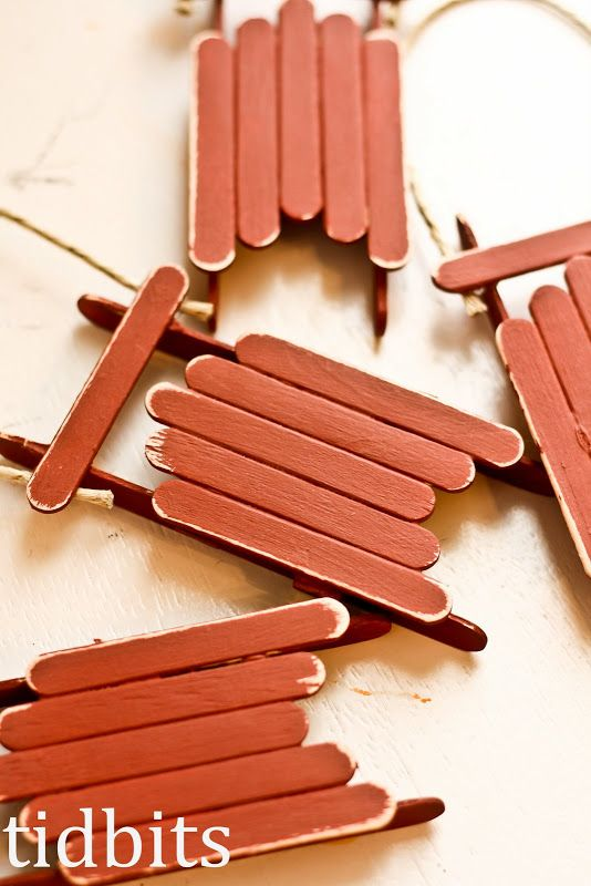DIY Sled Ornaments made from popcycle sticks.  Cute craft to do with the kiddos