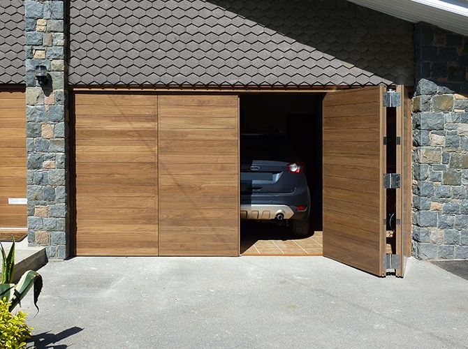 Automated bi-fold Garage doors in American Black Walnut.