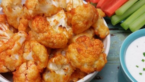 Buffalo cauliflower is a tasty appetizer of cauliflower coated in a buffalo dip-flavored breading that happens to be gluten-free!