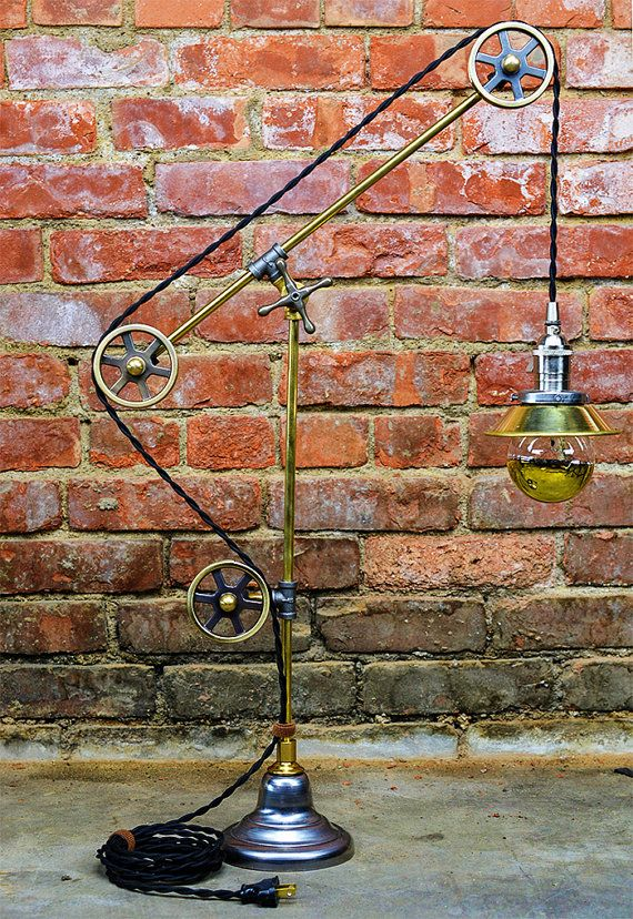 Hey, I found this really awesome Etsy listing at https://www.etsy.com/listing/238104213/pulley-table-light-steampunk-pulley-lamp