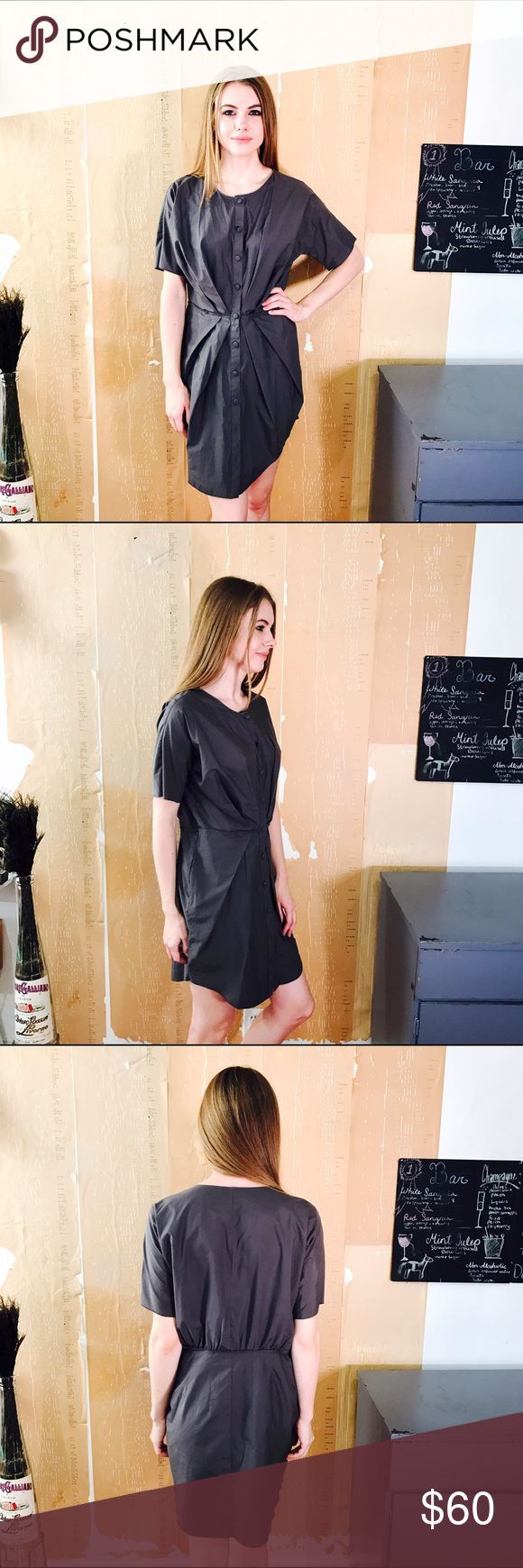 """UNIQLO X COSTELLO TAGLIAPIETRA DRESS #264 UNIQLO, Costello Tagliapietra, gray structured dress. Button up front. Short sleeve, size L CONDITION: EUC, No issues.  🎁 SHIPS WITHIN 24HRS  CHEST: 40"""" WAIST: 30""""  LENGTH: 34"""" INSEAM: *All measurements taken while item is laid flat (doubled when necessary) and measured across the front  MATERIAL: Cotton, Polyester  STRETCH: None INSTAGRAM @ORNAMENTALSTONE 🚫Trading Uniqlo Dresses Mini"""