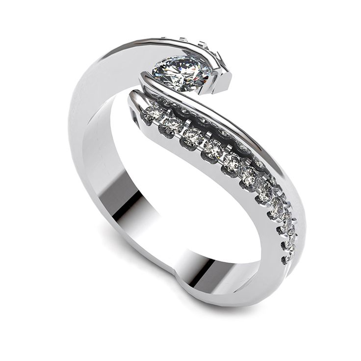 Diamond solitaire ring with diamond band.    www.uwekoetter.com