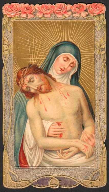 A vintage holy card of the pietà. I have one of these cards.  The roses and thorns are embossed. Lovely card.