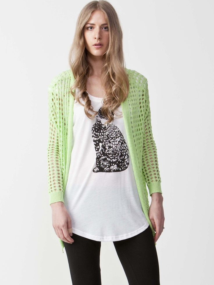Mary - Mesh Cardigan with round neckline. Ruffled trim with pockets. Regular fit and short length. $66.00