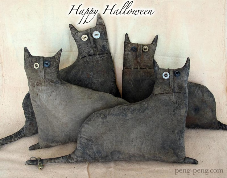 Cat pillows out of old black denim --  Another one I struggled with where to put it.  Is there a group for Pinterest addiction?
