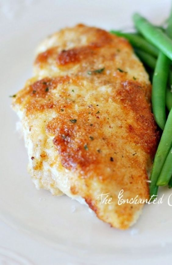 Parmesan Crusted Chicken Just mix mayo (1/2 c) and parm cheese (1/4 c), garlic powder, salt and pepper. Spread over chicken breast fillets in a baking dish, sprinkle italian bread crumbs on top and bake for 20-30 minutes.