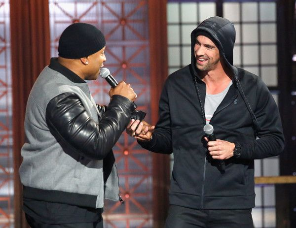 Michael Phelps Photos Photos - Host LL Cool J (L) and Michael Phelps perform onstage during Spike TV's Lip Sync Battle: All Stars Live on September 11, 2016 in Studio City, California. (photo by Trae Patton / Spike TV) - 'Lip Sync Battle: All Stars Live'