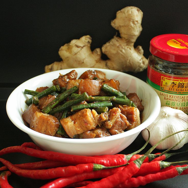There are probably many many Chinese dishes that one can prepare with a bottle of black bean garlic sauce, and I think cooking pork with said sauce is one of the more traditional approach. The recipe that comes with the bottle also uses pork (steamed pork in black bean sauce),