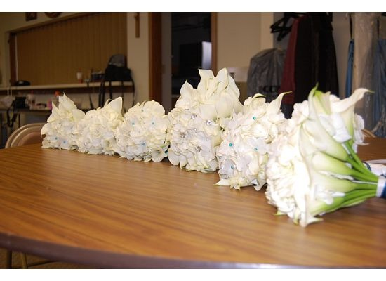Homemade bouquets All White Cala Lilies, Stephanottis surround  a hydrangea