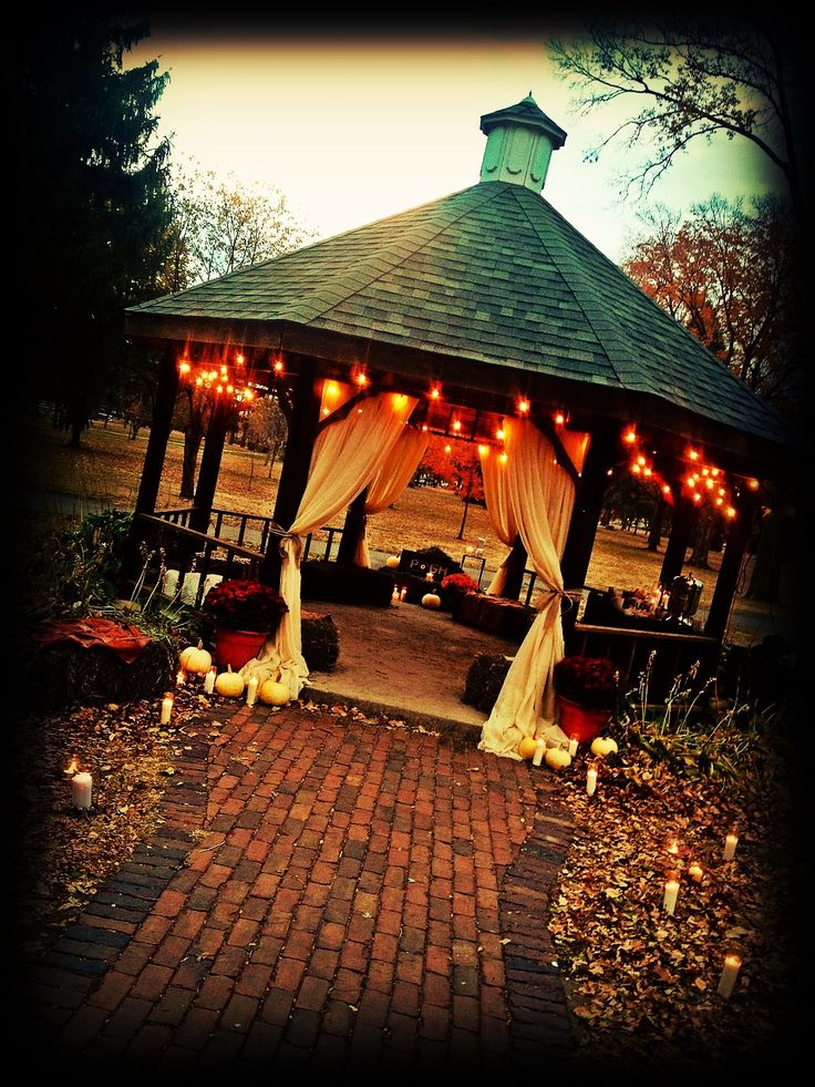one of my favorite, the lights and the drapes over the walk way. we could easily do that with some tuelle and put some of the pumpkins, mums, and other small decor at the bottom of the steps LOVE it