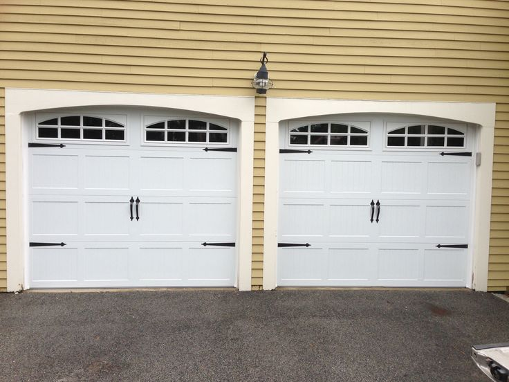 chi overhead doors model steel carriage house garage doors in white with cascade glass