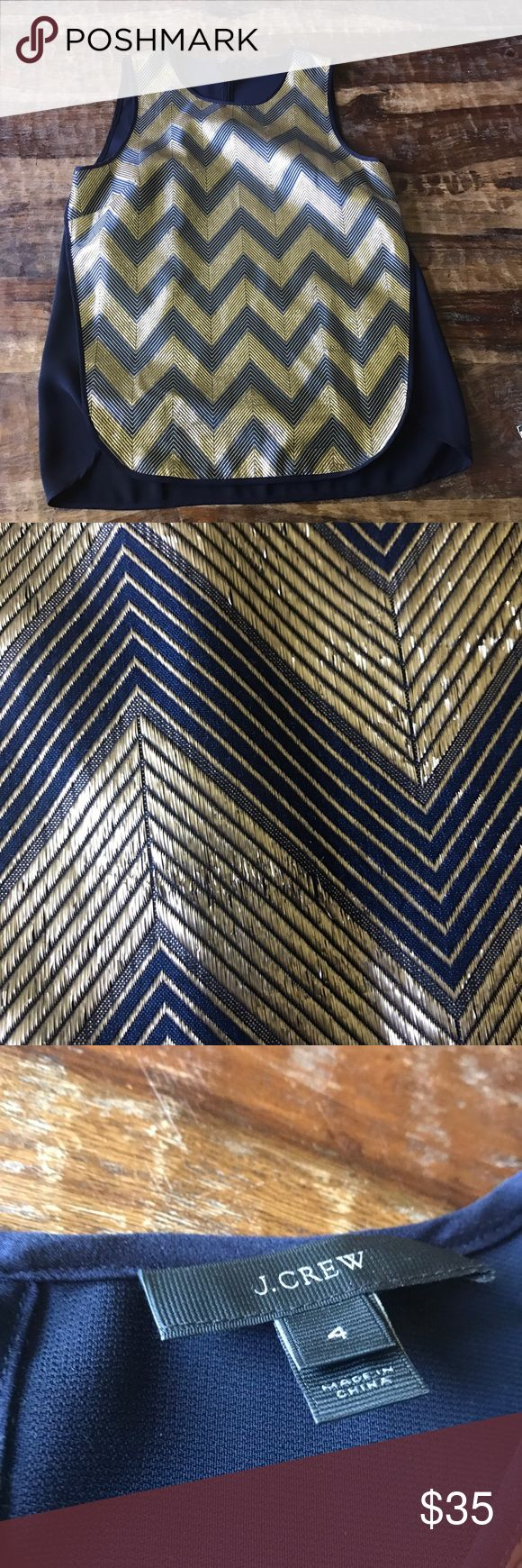 """J. Crew Gold Chevron Top Beautiful gilded gold Chevron tank top. In excellent condition with minor signs of wear. Color is navy blue and Metallic gold. Chest is 18"""" across laying flat and length is 25"""" J. Crew Tops Tank Tops"""