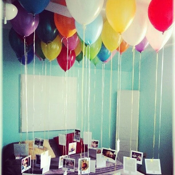 photos attached to helium filled balloons