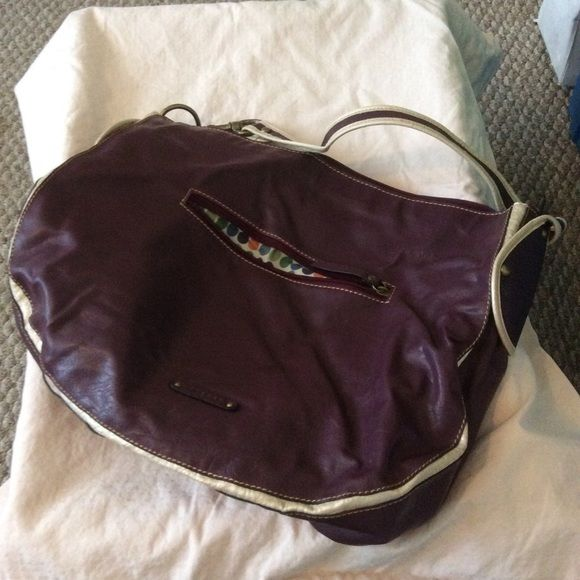 Eggplant color purse Eggplant color with dot pattern inside.  Only used a few times. Axcess Bags