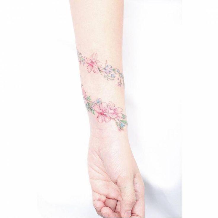 Flower bracelet scar cover tattoo.