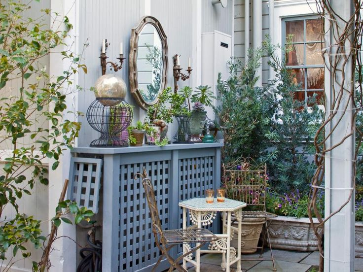 This custom lattice structure hides the garden hose and reminds us of an old school radiator cover LOVE THIS !!!!!!!!  !!!!  !!!!  !!!!  !!!!  !!!!  !