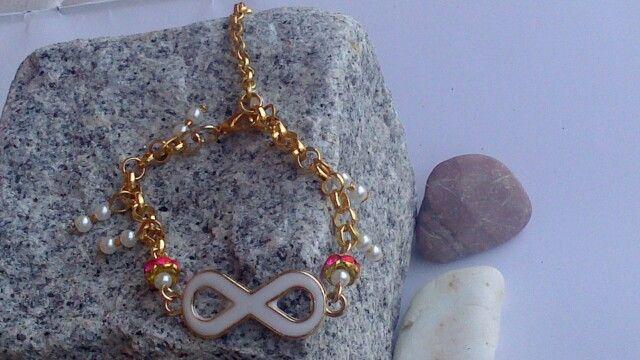https://www.facebook.com/beejeweledjewelry infinity bracelet white/gold/pink