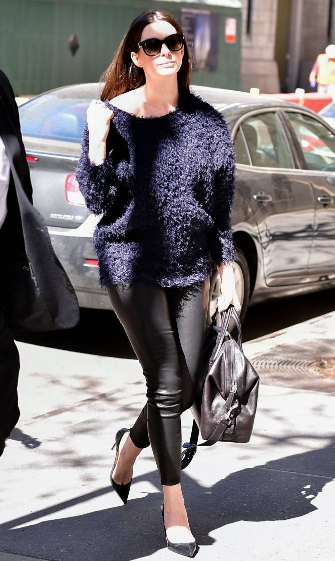 Anne Hathaway in a navy sweater, leather pants and pumps - click through for more spring outfit ideas