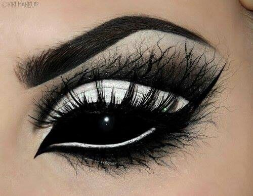 Willowy demon eyes chic demure , statement halloween fairy , angel or witch make up