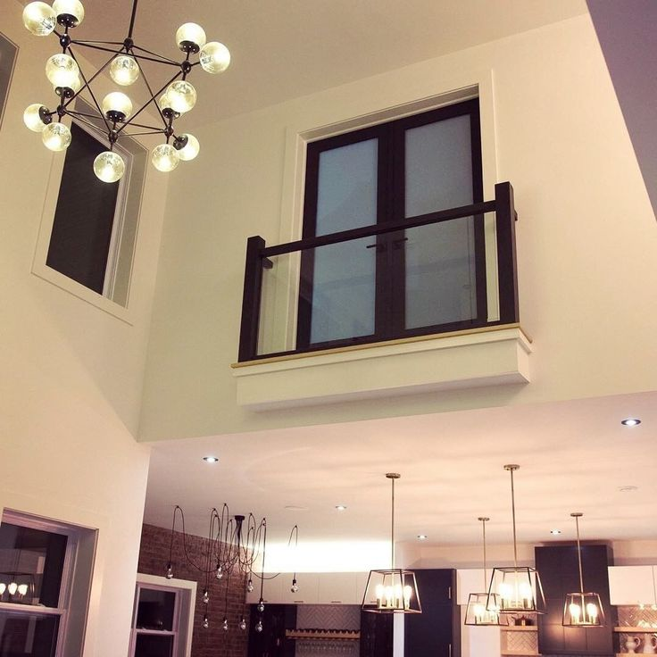 An interior balcony we installed railings and glass for.
